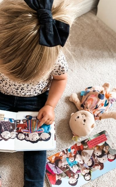 Picture of preschooler reading Little Bible Storybook from SU